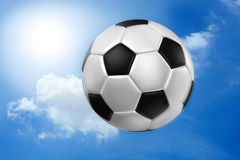 Football against blue sky . Royalty Free Stock Photography
