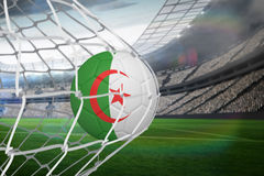Football in algeria colours at back of net Royalty Free Stock Image