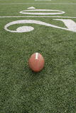 Football along the twenty yardline Stock Image