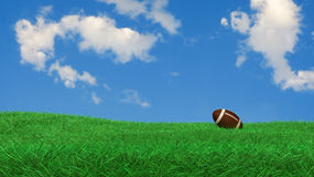 Football américain sur l'herbe Photos stock