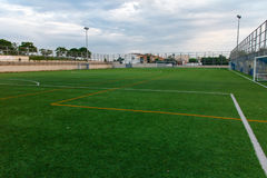 Football amateur stadium. Photography of football amateur stadium with green grass stock images