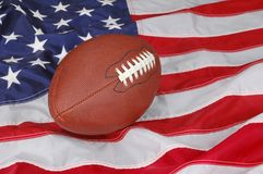 Football in America. American Football with flag in background Stock Images