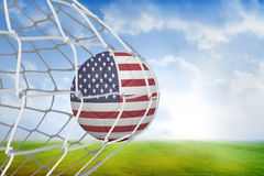 Football in america colours at back of net Stock Photo
