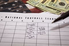 Football office pool grid for sports betting concept