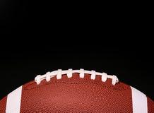 Football americano Palla sopra il nero immagini stock
