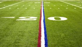 Football americano sopra il fie Fotografia Stock Libera da Diritti