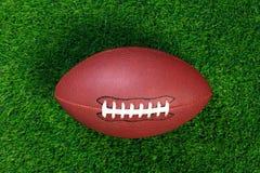 Football americano su erba fotografia stock libera da diritti