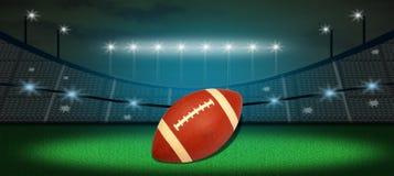 Football americano in terra Immagini Stock Libere da Diritti