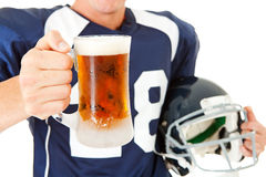 Football: Anonymous Player with Beer. Caucasian American football player, in uniform, isolated on white, with various related props Stock Image