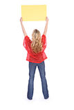 Football: Anonymous Woman Holding Up Sign Royalty Free Stock Photography