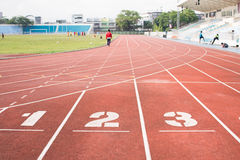 A football arena. Number 1,2,3 on a running lane in a football arena Stock Image
