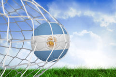 Football in argentina colours at back of net Stock Image