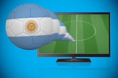 Football in argentina colours flying out of tv Royalty Free Stock Photos