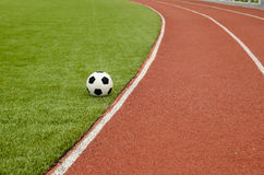 The football is on the artificial grass soccer field Royalty Free Stock Images