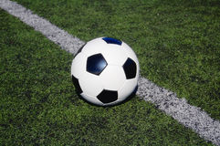 Football on astro turf Royalty Free Stock Photo