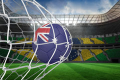 Football in australia colours at back of net Royalty Free Stock Photos