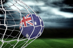 Football in australia colours at back of net Stock Photography