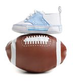 Football with baby shoes Stock Images