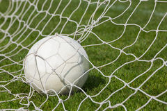 Football at the back of the net Stock Image