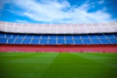Football background - blurred field on the modern stadium Stock Photos