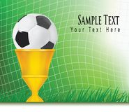 Football background with champion cup. Royalty Free Stock Images
