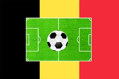 Football on the background of the field and the flag of Belgium Royalty Free Stock Photography