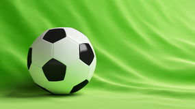 Football ball. On green fabric Royalty Free Stock Images