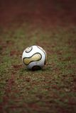 Football ball. Is laying on the grass Royalty Free Stock Photos