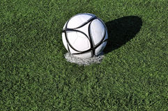 Football ball on apenalti point on a  grass Stock Photo