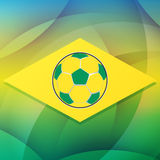 Football ball in Brazil flag, flat design. Soccer ball over Brazilian flag over green background, flat design Stock Photos