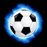 Football ball burning in blue fire Royalty Free Stock Photos
