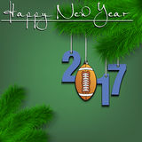 Football ball and 2017 on a Christmas tree branch Stock Images
