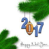 Football ball and 2017 on a Christmas tree branch Stock Image