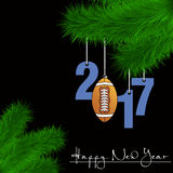 Football ball and 2017 on a Christmas tree branch Royalty Free Stock Photography