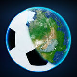 Football ball cover the planet earth. sports world Stock Images