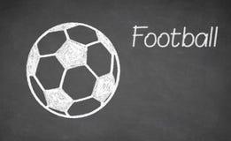 Football ball drawn on chalkboard. White chalk and balckboard stock images