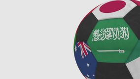 Football ball featuring different national teams accents flag of Saudi Arabia. 3D rendering. Football ball featuring different national teams accents flag of Royalty Free Stock Photography