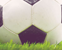 Football ball on field Royalty Free Stock Photography
