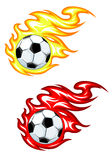 Football ball in fire flames. Football balls in yellow and red fire flames Royalty Free Stock Photos
