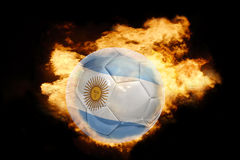 Football ball with the flag of argentina on fire Stock Photos