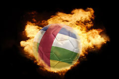 Football ball with the flag of central african republic on fire. Football ball with the national flag of central african republic on fire on a black background Royalty Free Stock Photos