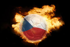 Football ball with the flag of czech republic on fire. Football ball with the national flag of czech republic on fire on a black background Royalty Free Stock Photography