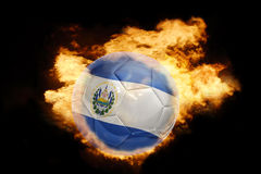 Football ball with the flag of el salvador on fire. Football ball with the national flag of el salvador on fire on a black background Royalty Free Stock Photo