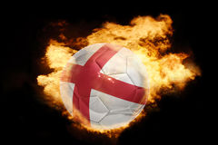 Football ball with the flag of england on fire. Football ball with the national flag of england on fire on a black background Stock Image