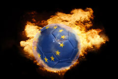 Football ball with the flag of european union on fire. Football ball with the national flag of european union on fire on a black background Royalty Free Stock Image