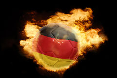 Football ball with the flag of germany on fire Royalty Free Stock Photo