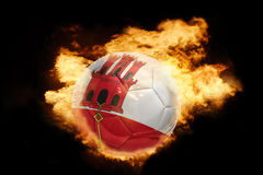 Football ball with the flag of gibraltar on fire Royalty Free Stock Photo