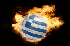 Football ball with the flag of greece on fire. Football ball with the national flag of greece on fire on a black background Stock Photography