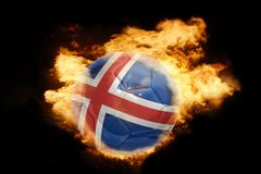 Football ball with the flag of iceland on fire. Football ball with the national flag of iceland on fire on a black background Royalty Free Stock Images