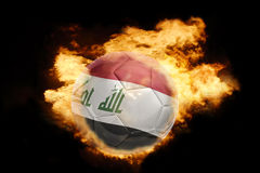 Football ball with the flag of iraq on fire. Football ball with the national flag of iraq on fire on a black background Royalty Free Stock Images